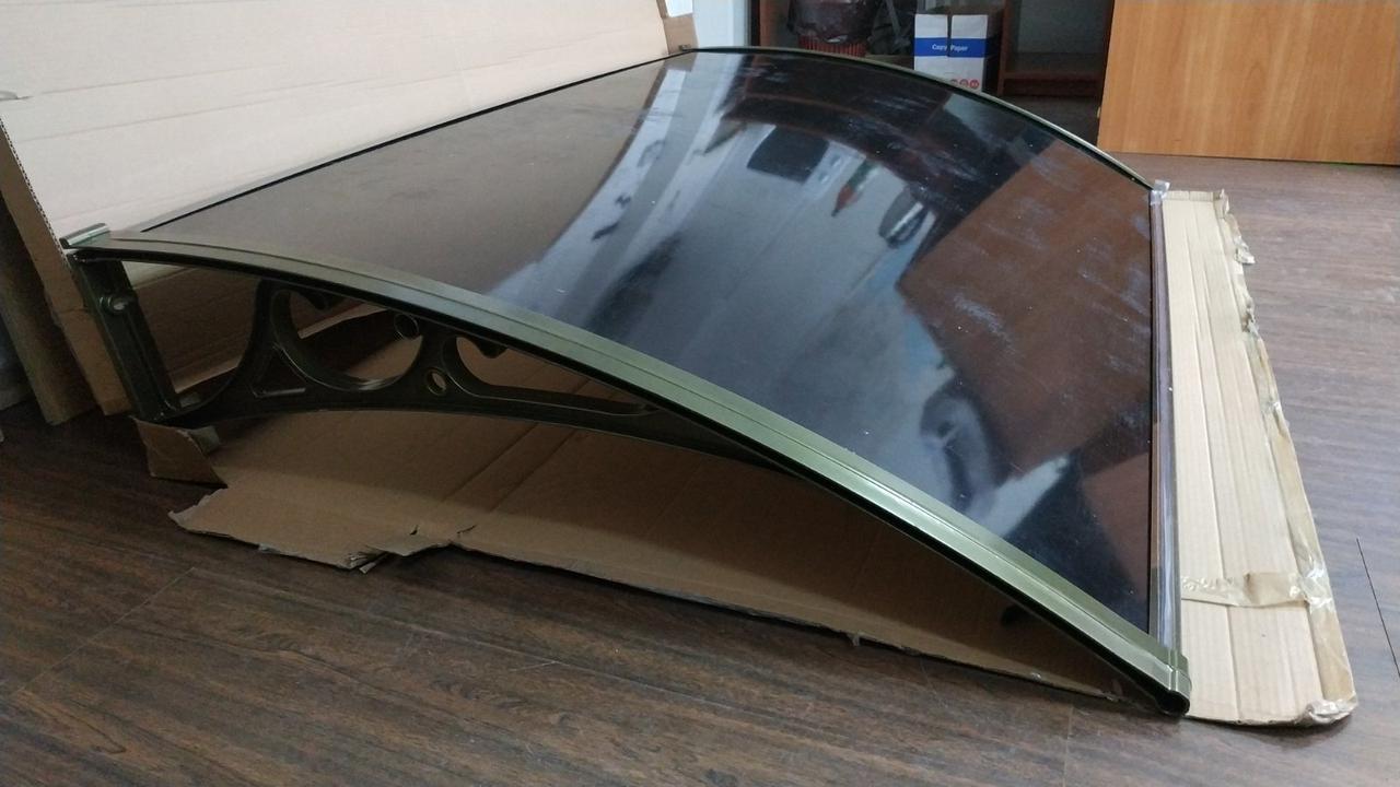 Козырек из литого поликарбоната, алюминиевые кронштейны 1,5х1м