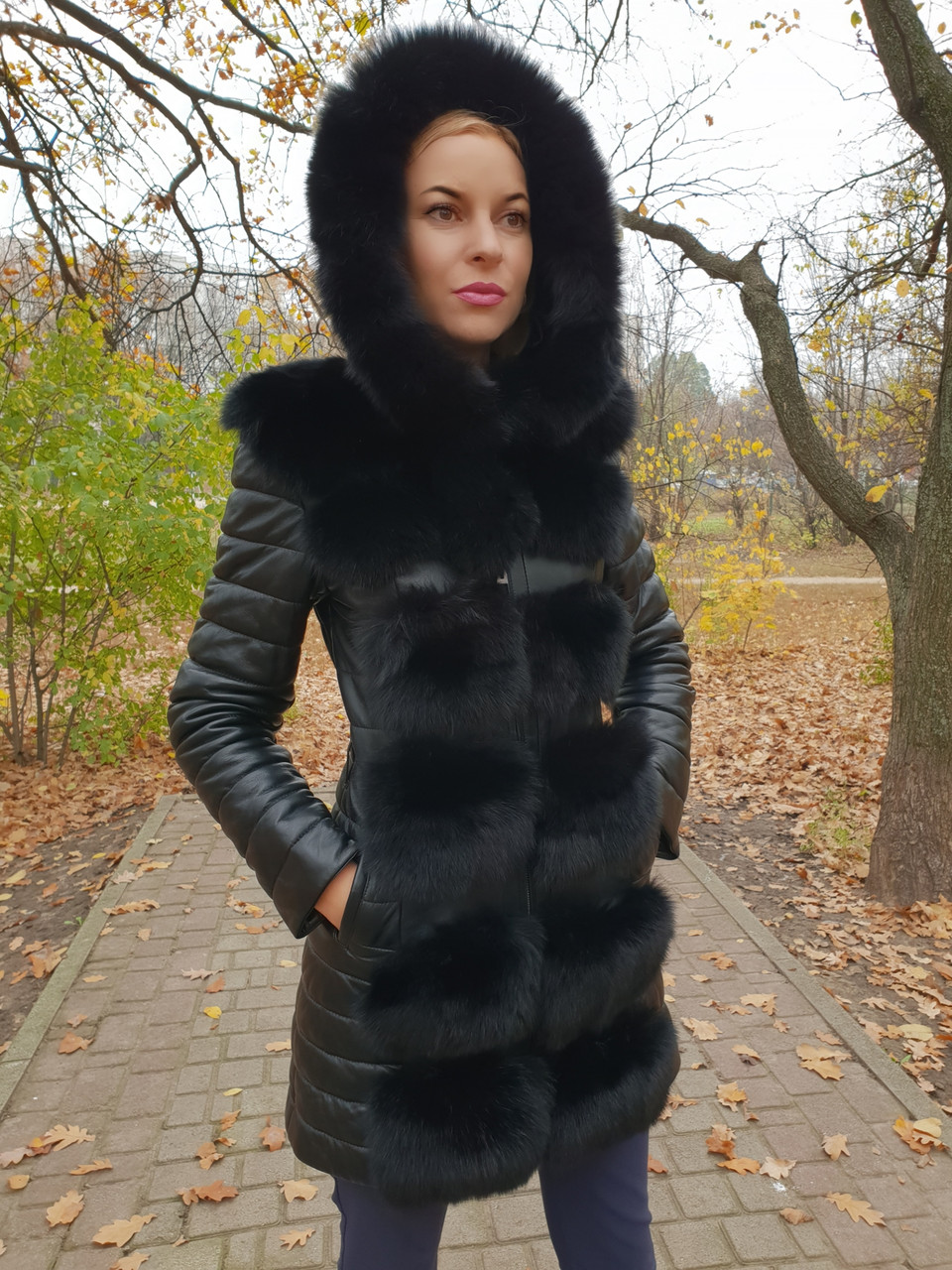 Жіноча зимова подовжена куртка з хутром