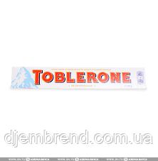 Toblerone Швейцарский молочный шоколад с медом и миндальной нугой Toblerone, 100 Г