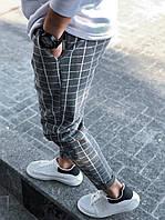 Мужские зауженные брюки серого цвета в клетку