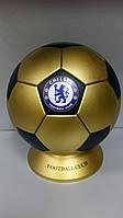 Копилка музыкальная с символикой FC Chelsea.