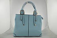 Голубая большая женская сумка держит форму из эко кожи