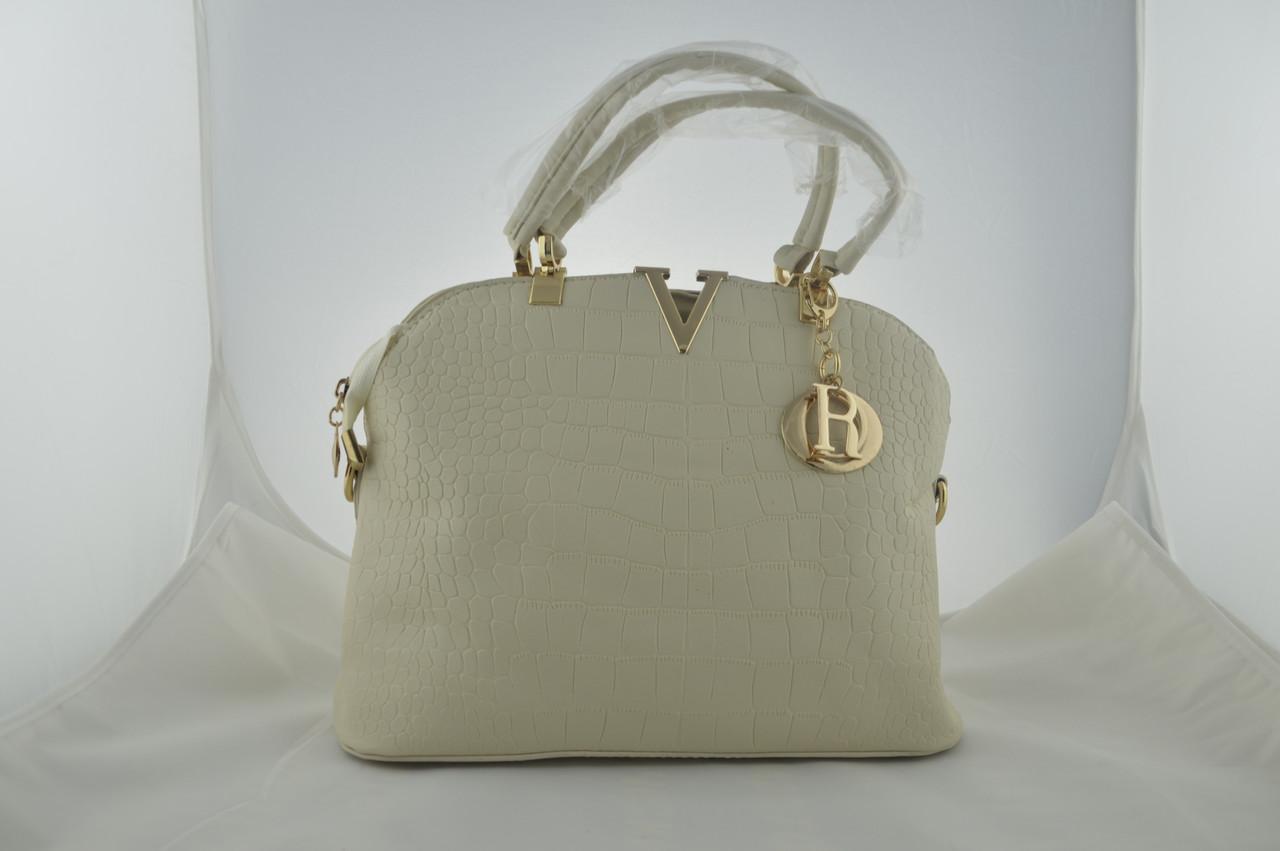 Женская белая сумка из эко кожи держит форму