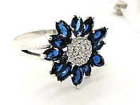 Женское кольцо с синими камнями Гербера