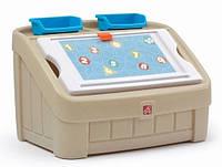2 в 1 комод для игрушек и поверхность для творчества Step 2 Box & Art 2 в 1 комод для игрушек и поверхность для творчества Step 2 Box & Art,