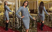 Женское вязаное платье с вырезами