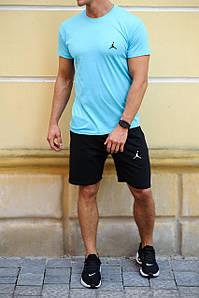 Блакитна футболка і чорні шорти з брендами (Nike, Adidas, Reebok, Under Armour, Jordan, Fila, Puma)