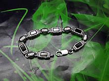 Срібний браслет з камінням онікс