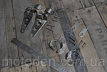 Набор кронштейнов крепления фары, передних и задних поворотников мотоцикла серебристые.