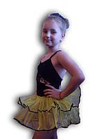 Купальник - пачка для гимнастики и танцев. Черный с желтым. Rivage Line 0220B