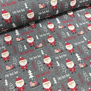 Ткань польская хлопковая, Санта Клаус с подарками в красных тонах на графитовом