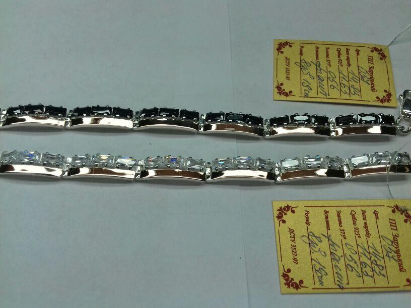 Серебряный браслет  с вставками золота 375 пробы и цирконом
