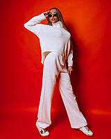 Женский вязаный костюм с брюками клеш и асимметричной кофтой 1810398, фото 1