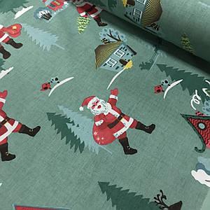 Хлопковая ткань (ТУРЦИЯ шир. 2,4 м) Санта Клаус с елками и домами на темно-зеленом