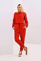 Красный женский модный костюм с карманами по бокам размер 44