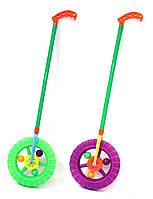 Каталочка игрушка колесо 059E  на палочке,трещетка, в пакете 14*14*3см