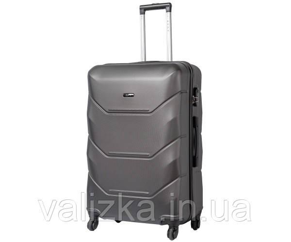 Великий пластиковий чемодан Fly на 4-х колесах темно-сірий