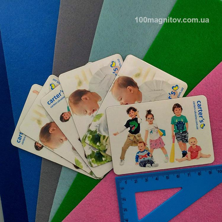 Виниловые магниты на заказ интернет-магазина детской одежды. Размер 95х65 мм