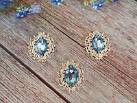 Металлический клеевой декор, 30х32 мм, цвет оправы светлое золото, цвет камня светло-голубой, 1 шт