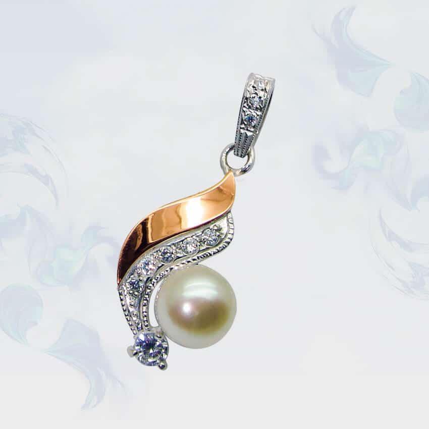 Подвеска из серебра с золотыми вставками