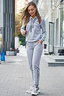 Женский трикотажный спортивный костюм с капюшоном. Серый