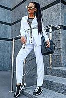 Белый женский костюм со штанами, пиджак на завязках. Летний