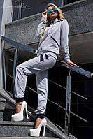 Женский трикотажный спортивный костюм на молнии, с синими вставками. Серый
