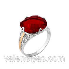 Серебряное кольцо с золотом и крупным красным фианитом
