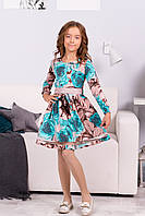 Нарядное платье для девочки с ярким рисунком
