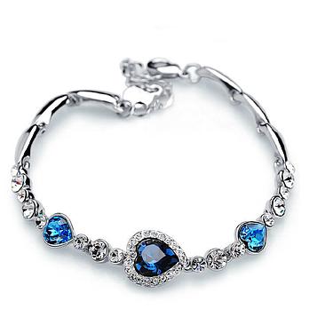 Браслет жіночий сріблястий з синіми сердечками код 1781