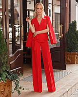 Женский деловой брючный костюм с пиджаком с необычными рукавами-крыльями