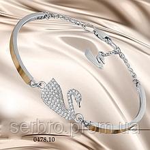 Серебряный браслет с золотом и фианитами Лебедь
