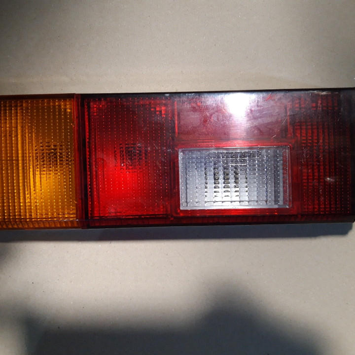 Левый задний фонарь Заз 1102 новый