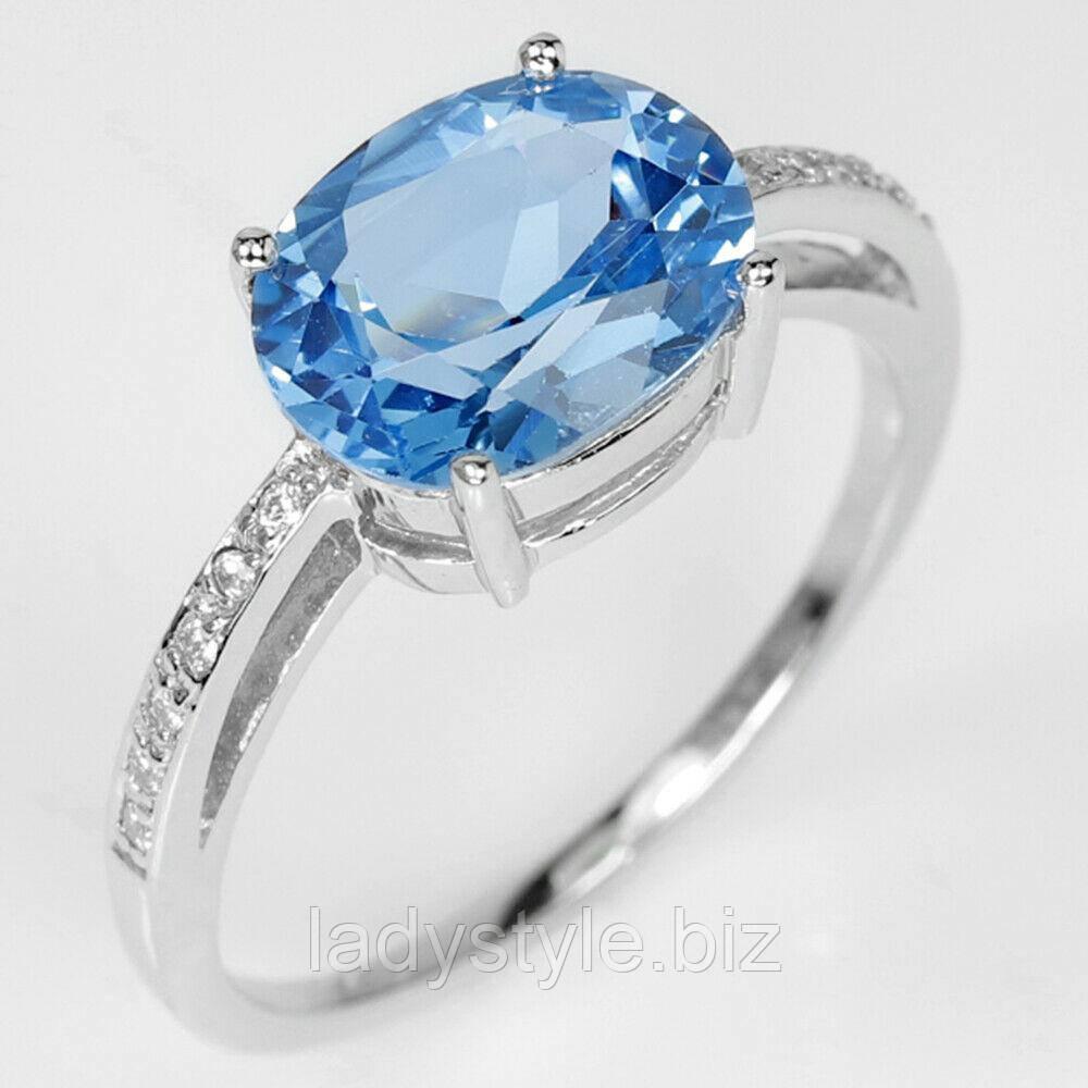 Серебряное кольцо с голубым лондон блю топазом и белыми сапфирами, размер 17.3