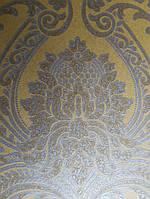 Обои флизелиновые  Khroma Serenade SER208 вензеля розетки завитки золотом на желтом фоне, фото 1