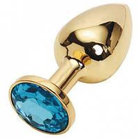 Золотая анальная пробка с голубым кристаллом, средняя