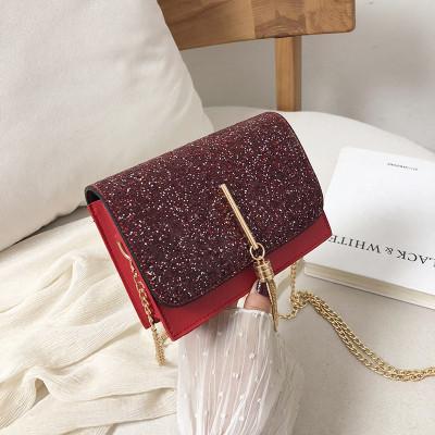 Блестящая красная сумочка с косточкой через плечо