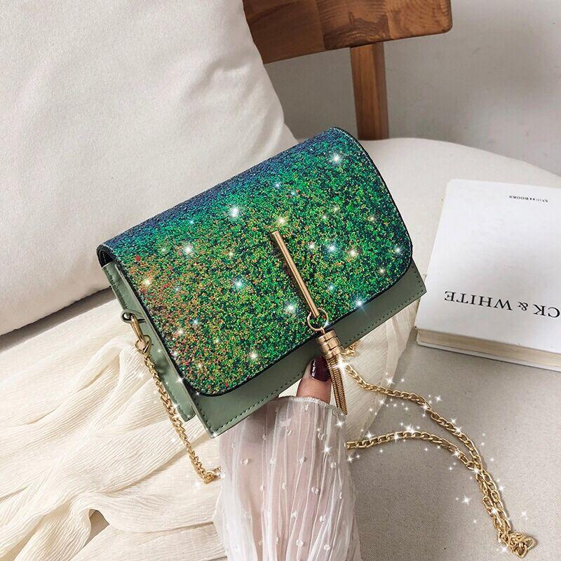 Блестящая зеленая сумочка с косточкой через плечо