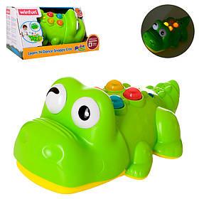 Гра 0699-NL крокодил24см,муз,звук,світло, рухає головою, на бат-ке, в кор-ке,26,5-17-14см