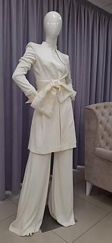 Свадебный костюм для невесты с бантом из органзы