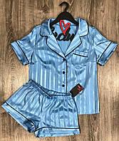 Голубая пижама рубашка и шорты с кантом.