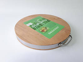Доска разделочная бамбуковая, с металлическим ободком d 37,2 cm, t=4 cm.