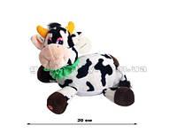 Корова с зеленой повязкой на шее, трясется 20см
