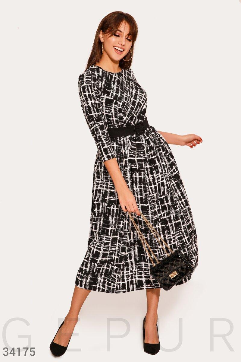 Стильное расклешенное платье-миди