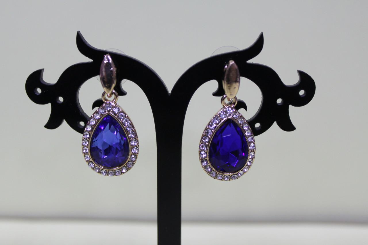 Изысканные сережки золотистые с синим камнем для любого мероприятия