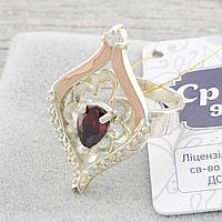 Серебряное кольцо с золотом Мадрид вставка красный фианит вес 4.8 г размер 17