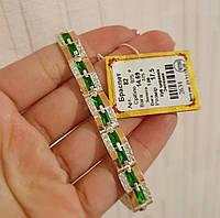 Серебряный браслет с золотыми напайками и двумя крупными зелеными камнями в центре 82у