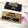 Бейдж на золотом метале с Вашим логотипом с окном для сменной информации