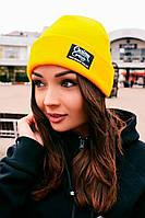 Теплая трикотажная шапка желтого цвета