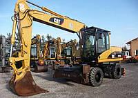Колёсный экскаватор Caterpillar M316с 2005 года